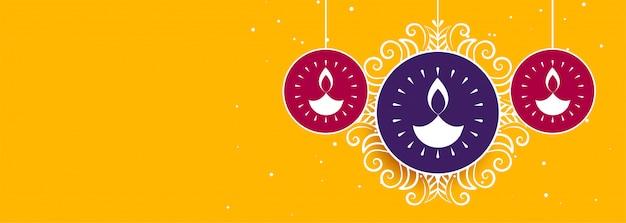 Banner de diwali amarelo com diya criativo