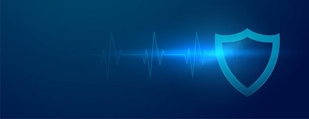 Banner de escudo médico com linhas de batida de coração cardiógrafo