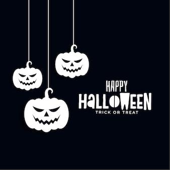 Banner de feliz dia das bruxas com assustadoras abóboras penduradas
