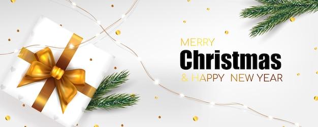 Banner de feliz natal e ano novo com caixa de presente