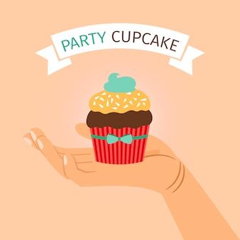 Banner de festa com a mão segurando o cupcake