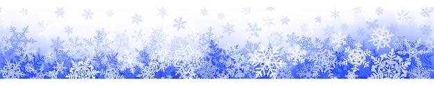 Banner de flocos de neve de natal complexos com repetição horizontal perfeita, em cores azuis. fundo de inverno com neve caindo