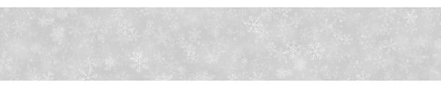 Banner de natal com flocos de neve de diferentes formas, tamanhos e transparências em fundo cinza