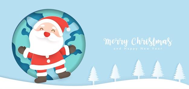 Banner de natal com um papai noel e o mundo.