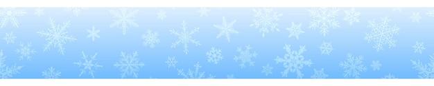 Banner de natal de complexos grandes e pequenos flocos de neve em cores azuis claras. com repetição horizontal