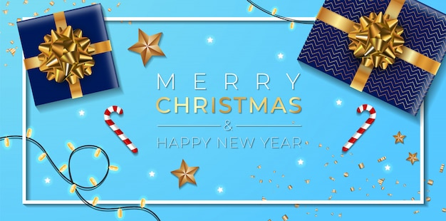 Banner de natal. projeto de natal de fundo da guirlanda de luzes brilhantes, com caixa de presentes realista, estrelas douradas e confetes de ouro glitter. mesa azul.