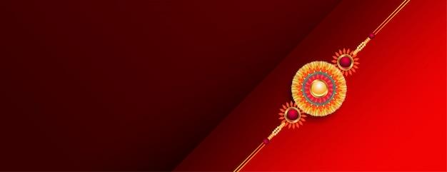 Banner de raksha bandhan vermelho bonito com rakhi dourado