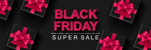 Banner de super venda black friday fundo horizontal escuro com caixa de presente preta com laços rosa