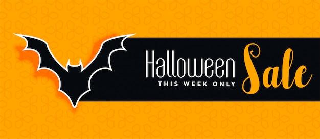 Banner de venda amarelo de halloween com silhueta de morcego