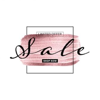 Banner de venda com mão de ouro rosa pintado escova no fundo branco