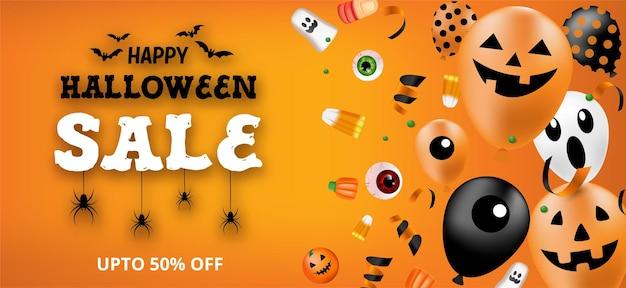 Banner de venda de feliz dia das bruxas com balões e doces.