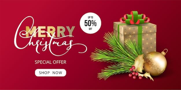 Banner de venda de feliz natal e ano novo com um presente e decorações festivas