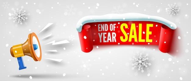 Banner de venda de fim de ano com tampa de neve de fita vermelha de megafone e flocos de neve.