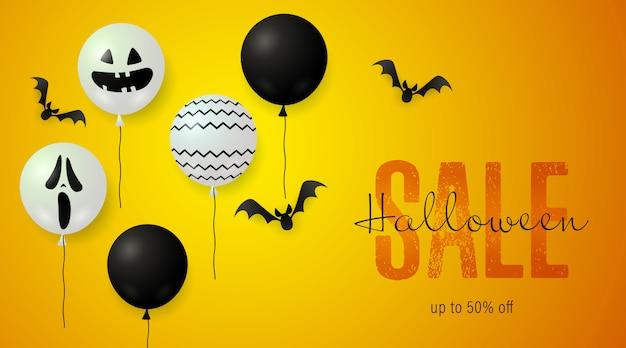 Banner de venda de halloween com balões assustadores e morcegos