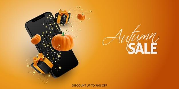 Banner de venda de halloween com caixa de presente de confete para smartphone e abóbora realista em fundo laranja
