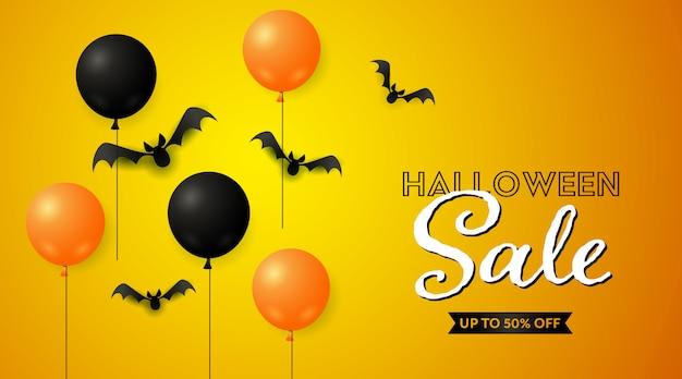 Banner de venda de halloween com morcegos e balões