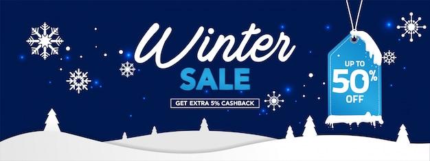 Banner de venda de inverno com flocos de neve em fundo azul