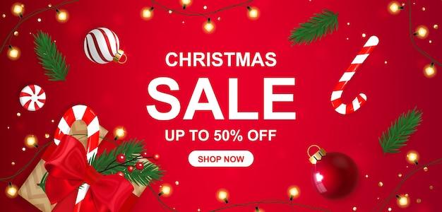 Banner de venda de natal com 50% de desconto em caixa de presente.