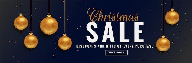 Banner de venda de natal com bolas de ouro