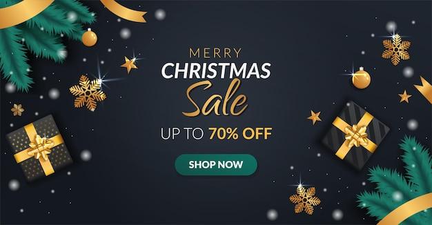 Banner de venda de natal com caixas de presente e fitas douradas