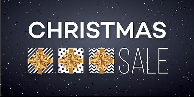 Banner de venda de natal com caixas de presentes com laço de ouro.