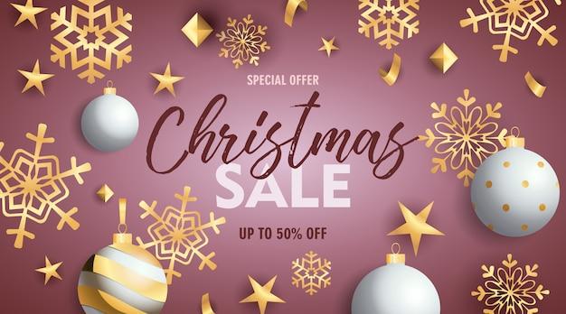 Banner de venda de natal com enfeites e flocos de neve dourados