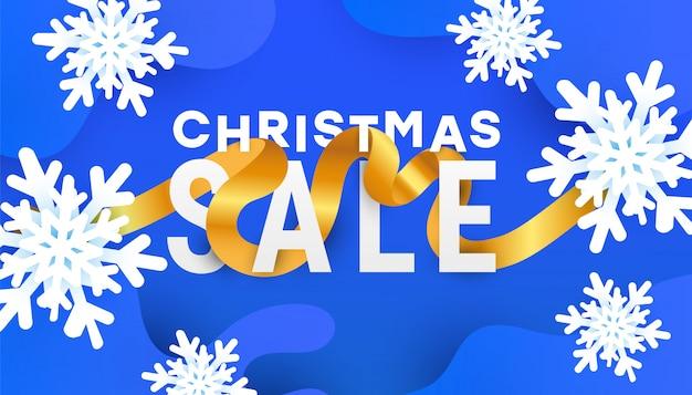 Banner de venda de natal com flocos de neve de ar e fita de ouro