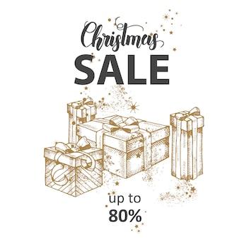 Banner de venda de natal com letras feitas à mão e caixas de presente festivo dourado