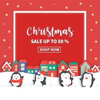 Banner de venda de natal com pinguins fofos.