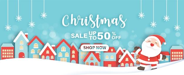 Banner de venda de natal com uma linda clasue de papai noel e no estilo de corte de papel.