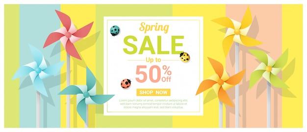 Banner de venda de primavera com cata-ventos coloridos