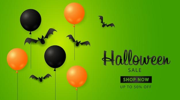 Banner de venda do dia das bruxas com balões e morcegos
