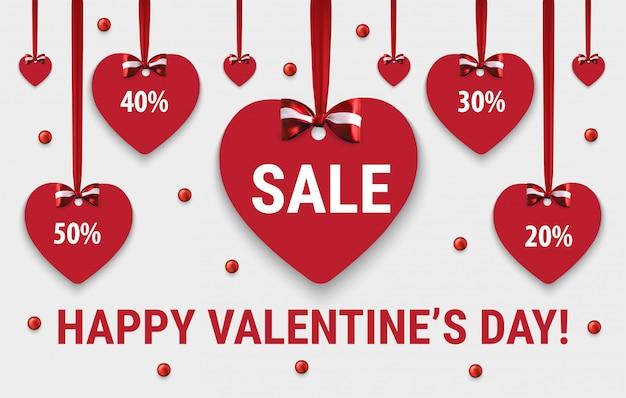 Banner de venda feliz dia dos namorados. corações com laços