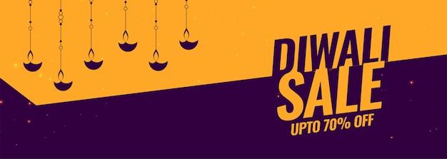Banner de venda festival de diwali com decoração de lâmpada de diya