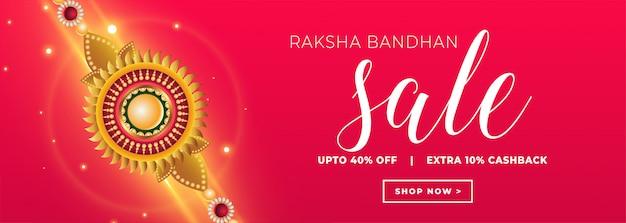 Banner de venda raksha bandhan com rakhi dourado
