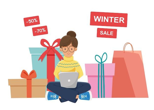 Banner de vendas de inverno. a menina está comprando presentes e presentes online. cartaz de inverno de plano de fundo, cartão de felicitações, ilustração para o site