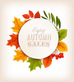 Banner de vendas de outono com folhas coloridas.