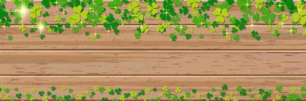 Banner de vetor horizontal de madeira do dia de são patrício com folhas coloridas de trevo