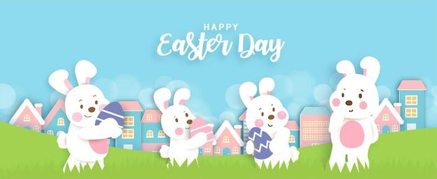 Banner do dia de páscoa com coelhos fofos e ovos de páscoa