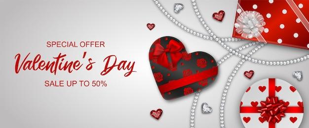 Banner do dia de valentin com caixas de presente e diamantes