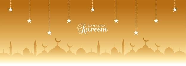 Banner dourado ramadan kareem com estrelas e mesquita