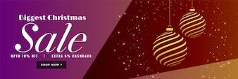 Banner elegante de venda de Natal com bola dourada criativa