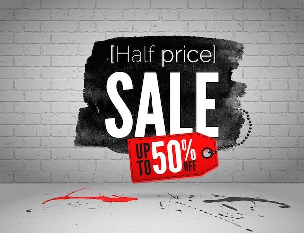 Banner em aquarela de venda pela metade do preço com respingos de tinta no fundo grunge de tijolo branco