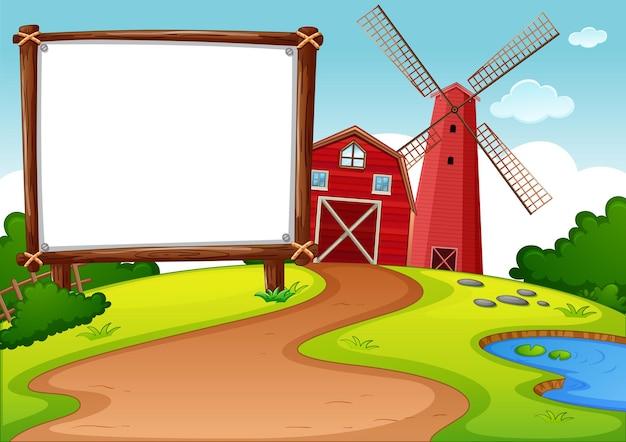 Banner em branco em fazenda com celeiro vermelho e cena do moinho de vento