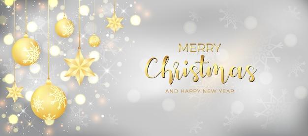 Banner espumante de feliz natal e feliz ano novo com bola de natal decorada e iluminação