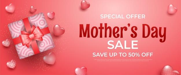 Banner feliz dia das mães com corações e caixa de presente rosa