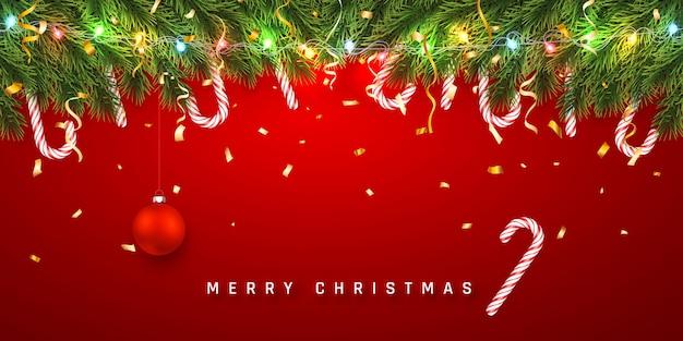 Banner festivo de natal com galhos de árvore de natal com pirulito e guirlanda de luz.