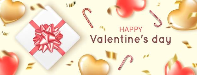 Banner horizontal com balões vermelhos e dourados em forma de coração.