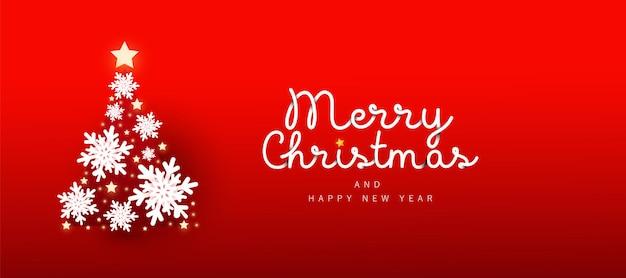 Banner horizontal feliz natal e feliz ano novo de 2021 com neve decorada na árvore de natal