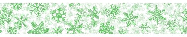Banner horizontal sem costura de natal de muitas camadas de flocos de neve de diferentes formas, tamanhos e transparência. verde em branco